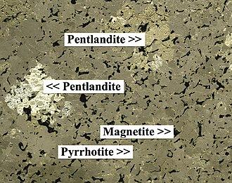 Pentlandite - Pentlandite in pyrrhotite, ore specimen from the Sudbury Basin (field of view 3.4 cm)