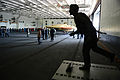Personnel move a U.S. Navy X-47B Unmanned Combat Air System demonstrator aircraft past a statue of George H.W. Bush in the hangar bay of the aircraft carrier USS George H.W. Bush (CVN 77) in Norfolk, Va., May 6 130506-N-FU443-457.jpg