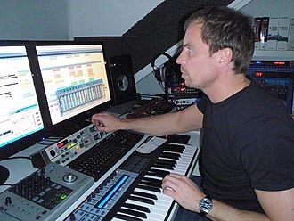 Music technology - This 2009 photo shows music production using a digital audio workstation (DAW) with multi-monitor setup.
