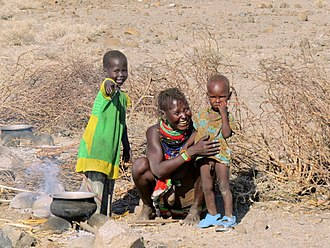 Turkana people - Poor Turkana mother preparing a one-pot meal.
