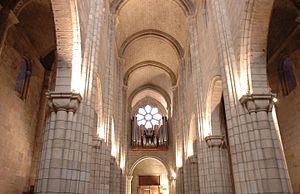 Porto Cathedral - Inner view of rose window and central aisle of Porto Cathedral.