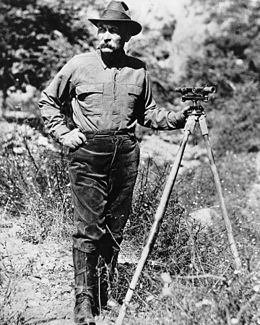 Portrait of William Mulholland with a surveyor's scope on a tripod, ca.1908-1913 (CHS-14459).jpg