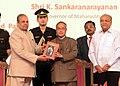 Pranab Mukherjee receiving a copy of biographical book titled 'Rajarshi Shahu Chhatrapati - A Royal Revolutionary King', by the historian, Dr. Jaysingrao Pawar from the Governor of Maharashtra, Shri K. Sankaranarayanan.jpg