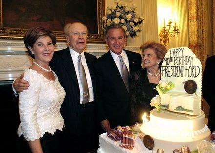 Ford at his 90th birthday with Laura Bush, President George W. Bush, and Betty Ford in the White House State Dining Room in 2003 Presford90.jpg