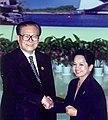 President Gloria Macapagal-Arroyo is greeted by China's President Jiang Zemin.jpg