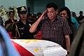 President Rodrigo R. Duterte salutes a soldier killed in combat with the Abu Sayyaf in Sulu.jpg