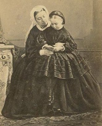 Princess Beatrice of the United Kingdom - Queen Victoria holding Princess Beatrice in 1862