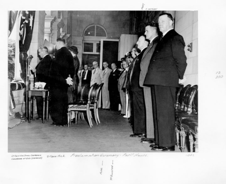 The Governor of Queensland proclaims the accession of Queen Elizabeth II. Queensland State Archives 4856 Proclamation Ceremony Parliament House c 1952.png