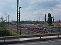 Railway yard, cartransport wagons from Route 81 overpass bridge, 2018 Győr.jpg
