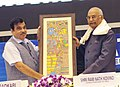 Ram Nath Kovind being presented a memento by the Union Minister for Road Transport & Highways, Shipping and Water Resources, River Development & Ganga Rejuvenation, Shri Nitin Gadkari.jpg