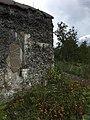 Rapistunut seinä Vallisaaressa.jpg