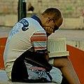 Reading in an absorbed way (15380444156).jpg