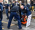 """Rebellion of One Rebel of Extinction Rebellion is removed by the police after blocking a road, sign reads """"I am afraid of war in Europe because of the climate crisis."""" (51075796103).jpg"""