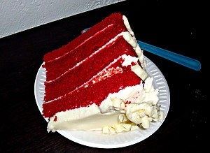 Photograph of a slice of a 4-layer red velvet ...