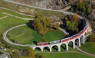 Rhaetian Railway ABe 4/4 III -  Two Rhaetian Railways ABe 4/4 III multiple units with a local train from St. Moritz to Tirano are just crossing the Brusio spiral viaduct
