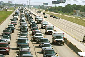 Emergency evacuation - Evacuees on Interstate 45 leaving Galveston, through Houston, during Hurricane Rita in 2005. Note how no south-bound lanes (right) were used as north contra-flow lanes for vehicles turning west.