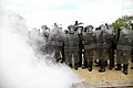 Romanian soldiers with the 1st Company, 22nd Battalion prepare to advance through a smoke screen while conducting riot control operations as part of the Kosovo Force (KFOR) 17 Mission Rehearsal Exercise at 130506-A-HJ139-007.jpg