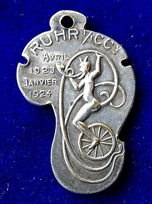 Gustave Michel - Ruhr Occupation, French Art Medal 1924 by Michel. Reverse: The devil riding on a unicycle l., and playing a French horn.