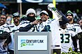 Russell Wilson, Marshawn Lynch with Lombardi Trophy.jpg