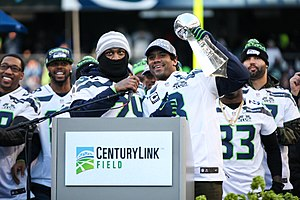 2013 NFL season - Russell Wilson and Marshawn Lynch with the Vince Lombardi Trophy at the CenturyLink Field in Seattle, February 5, 2014