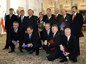 Council of Ministers (Poland) - The assembled cabinet of Prime Minister Marek Belka (middle row, second from left) with President Aleksander Kwaśniewski (middle row, third from left) in 2005.