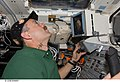 S125-E-006661 - Commander Scott Altman working the controls of the RMS during STS-125.jpg