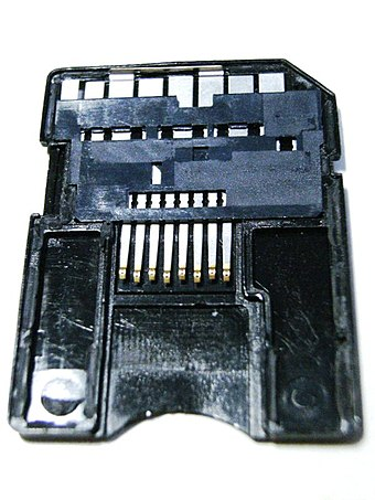 Dismantled microSD to SD adapter showing the passive connection from the microSD card slot on the bottom to the SD pins on the top SD-microSD adaptor.jpg