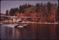 SEAPLANE TAXIING ON SMOOTH WATER AT SEVENTH LAKE IN THE ADIRONDACK FOREST PRESERVE - NARA - 554656.tif