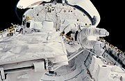 STS-41-G Sullivan checks SIR-B antenna latch