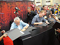 San Diego Comic-Con 2011 - Stan Lee and Morgan Spurlock sign the Episode IV- A Fan's Hope book for fans (Sideshow Collectibles booth) (5977012904).jpg