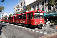 The San Diego Trolley going through downtown.