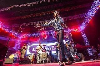 Afrobeat West African music genre, distinct from Afrobeats