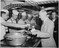 Secretary of State James Byrnes carries his lunch tray through the crew's mess hall on the U. S. S. Augusta. He is... - NARA - 198743.tif