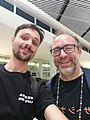 Shikeishu before boarding a plane with Jimmy Wales after Wikimania 2018.jpg