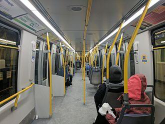 Bombardier Innovia Metro - Image: Skytrain Mk 3 interior toward center