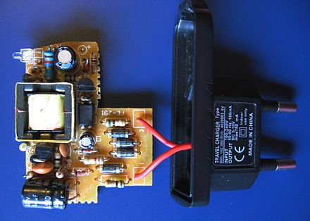 This charger for a small device such as a mobile phone is a simple off-line switching power supply with a European plug. The simple circuit has just two transistors, an opto-coupler and rectifier diodes as active components. SmSntWoIc.jpg