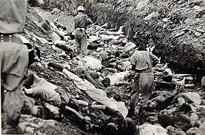 Truth and Reconciliation Commission (South Korea) - Image: South Korean soldiers walk among dead political prisoners, Taejon, South Korea