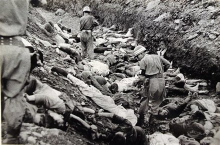 South Korean soldiers walk among the bodies of political prisoners executed near Daejon, July 1950 South Korean soldiers walk among dead political prisoners, Taejon, South Korea.jpg