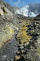 Stream through sulphur deposits on White Island.jpg