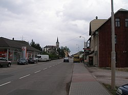 The main road and church of St. John the Baptist