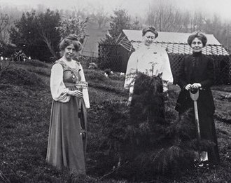 Eagle House (suffragette's rest) - Annie Kenney to the left, Blathwayt at centre and Emmeline Pankhurst, with the spade, at Eagle House in 1910