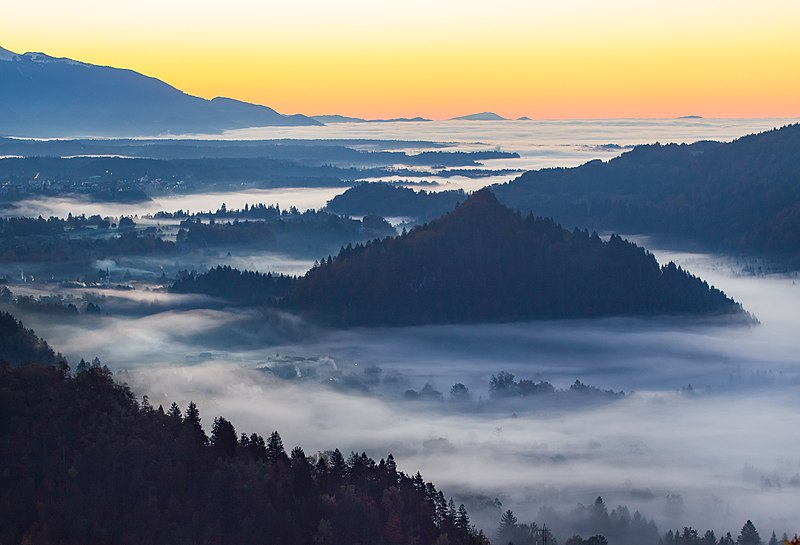 Sunset over a misty valley (Unsplash).jpg