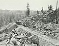 Superintendent Duncanson precedes a train over a new trestle, 1912.jpg