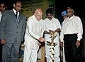 Sushil Kumar Shinde lighting the lamp to inaugurate the function of Perform, Achieve and Trade (PAT) Programme of NMEEE, in New Delhi on July 04, 2012. The Minister of State for Power, Shri K.C. Venugopal is also seen.jpg