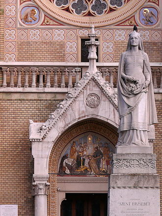 Elizabeth of Hungary - A statue showing the miracle of the roses in the rose garden in front of the neo-Gothic church dedicated to her at Roses' Square (Rózsák tere), Budapest.
