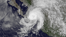 A visible satellite image of Tropical Storm Manuel approaching hurricane intensity just offshore southwestern Mexico on September 18.