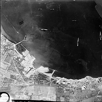 Battle of Taranto - Aerial photo of Italian warships moored in Mar Grande harbour at Taranto. Note the 'Y' jetty.
