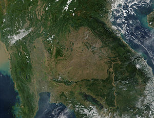 Geography of Laos - This is a 2001 MODIS image of southeastern Asia. In eastern Thailand, the brown coloring that dominates the center of the image and mimics the country's border with Laos and Cambodia, speaks of the massive deforestation that occurs in this region. Deforestation has played a major role in flooding in the region.