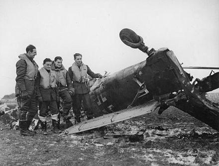 RAF pilots examine a Ju 87, shot down while attacking a convoy. The Battle of Britain 1940 CH2064.jpg