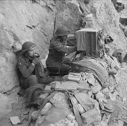 Signallers of the 6th Battalion, Queen's Own Royal West Kent Regiment using a radio in a dugout on Monastery Hill. The Battle of Cassino, January-may 1944 NA13363.jpg